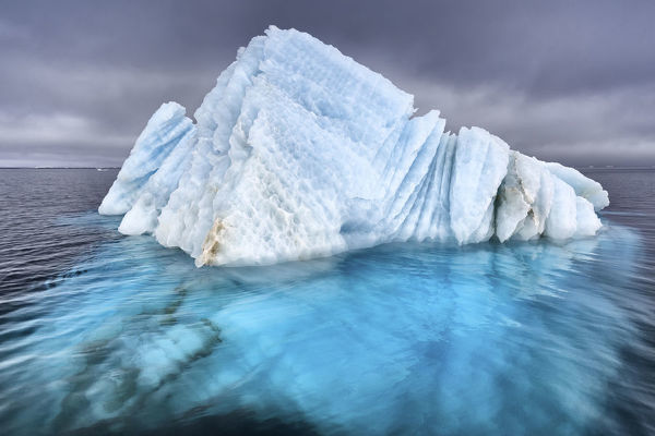 Natural ice sculpture floating at sea in Svalbard, Norway