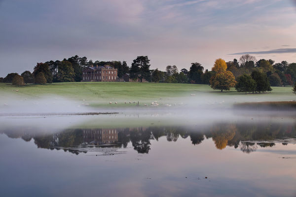Berrington Hall reflected in lake at dawn, Herefordshire, England, UK, October 2015