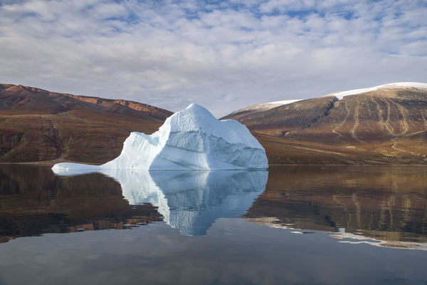 Iceberg and reflection, in Rode Fjord (Red Fjord), Scoresby Sund, Greenland, August