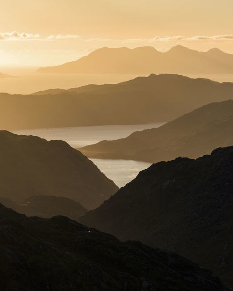 Mountain view towards Loch Nevis overlooking Knoydart peninsula with Skye beyond