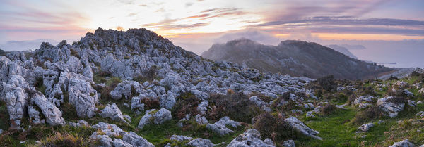 Panoramic landscape of Cerredo mountain at sunset, Castro Urdiales, Cantabria, Spain