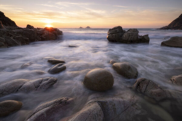 RF - Rocks on Porth Nanven beach at sunset. Cot Valley, near St Just, Cornwall, England