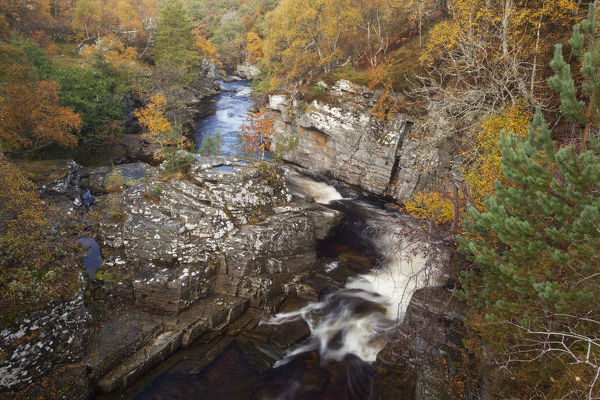 River Tromie flowing through a small gorge in autumn. Cairngorms, Scotland, October 2009