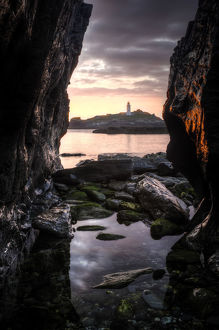 latest highlights/highlights 2011/godrevy lighthouse sunset seen rocksand rockpool