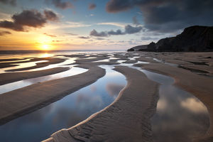 ross hoddinott/sandymouth bay evening light north cornwall uk